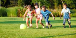 Photo: Children play soccer in a park