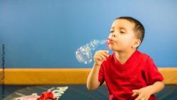 Image: little boy with soap bubbles; Copyright: Children's National Health System