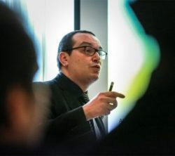 Photo: Man with glasses and dark hair is giving a lecture - Dr. Walaa Khaled