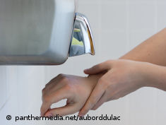 Photo: Two hands under a hand dryer