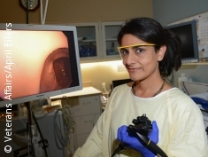 Photo: Female physician with colonoscope