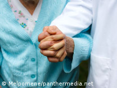 Photo: Physician holding an old patient's hand