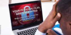 Image: View on laptop screen with message that data was encrypted; Copyright: panthermedia.net/Andriy Popov