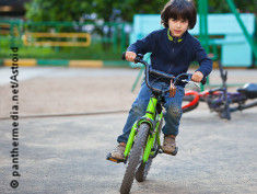 Photo: Boy riding a bike