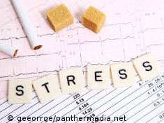 Photo: ECG printout, cigarettes, sugar and the word stress