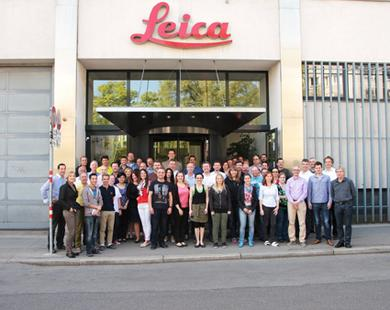 Leica Microsystems' EM sample preparation business in Vienna obtained the DIN EN ISO 14001 certification for environmental management – the image shows the Vienna team in front of the building.
