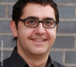 Photo: Smiling young man with glasses and dark hair - Dr. Mitsakakis Konstantinos; Copyright: IMTEK & Hahn-Schickard