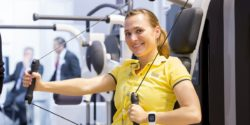 Photo: Young woman uses an exercise device at MEDICA