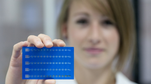 Photo: Young woman with prototype plastic card