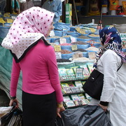 Photo: Women covered by headscarf with shopping bags