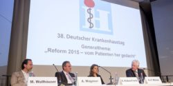 Photo: Podium and speakers at the 38. German Hospital Conference
