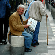 Picture: An old man reading a newspaper