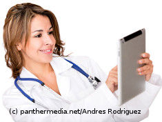 Photo: Woman holding a tablet