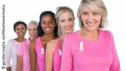 Photo: Women dressed in pink with Breast Cancer Awareness Ribbons