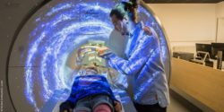 Image: Girl in the MRI, physician besides; Copyright: Klinikum Dortmund/Dr. Lindel