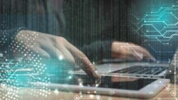 Image: Hands in front of a computer and tablet; Copyright: panthermedia.net/Andrew Lozovyi