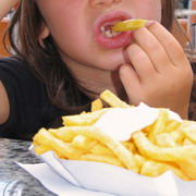 photo: a child eating french fries