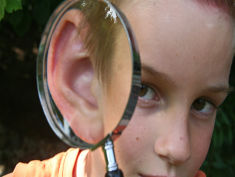 Photo: Child with magnifying glass