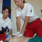Photo: 2 women learning to do cardiopulmonary resuscitation