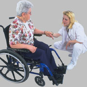 Photo: Older woman in a wheelchair and a nurse