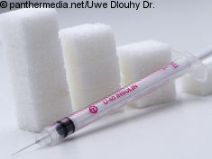 Photo: Insulin shot in front of sugar cubes