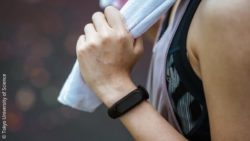 Image: A wrist of a woman in sport clothes with a wearable device; Copyright: Tokyo University of Science