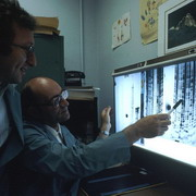 Photo: Two men studying a screen with DNA