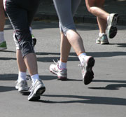 Photo: Three runners' legs and feet