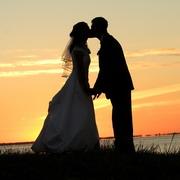 Photo: Bride and groom kissing