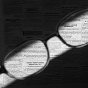 Photo: Glasses over newspaper, sharpens the letters