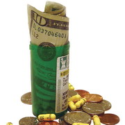 Photo: Money in a pill bottle with pills and coins around