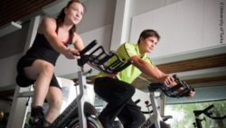 Image: A woman and a man in a spinning class; Copyright: University of Turku