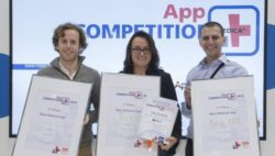 Image: Two men and a woman, the winners of MEDICA App COMPETITION 2015, holding in their hands their winner's certificate