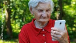 Photo: Old woman with a smartphone
