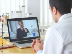 Photo: Physician and patient at video conference