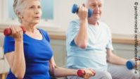 Photo: Elderly woman and elderly man while strength training