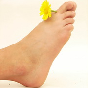 Photo: Bare foot with flower between the toes
