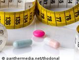 Photo: Measuring tape and pills
