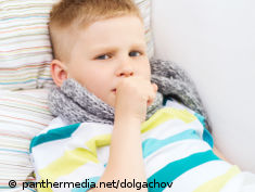 Photo: Boy with a cough in bed