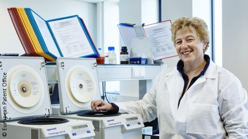 Photo: Smiling female researcher in the lab