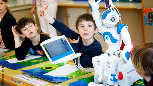 Photo: Children in a classroom learn with avatar robot