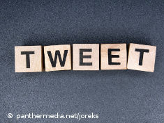"Photo: Letters on wood cubes spelling ""tweet"""