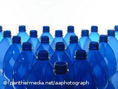 Photo: A lot of blue plastic bottles