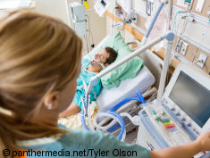 Photo: Man lying in bed at ICU