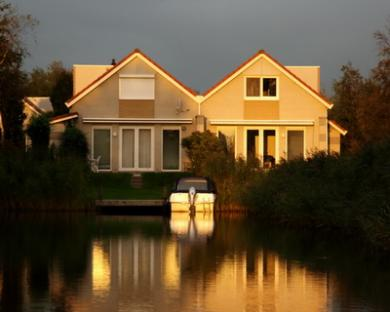 Photo: Two houses on the lake at sunset
