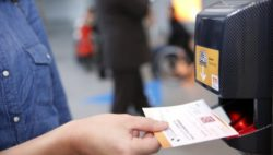 Photo: e ticket and bar code scanner at the turnstile; Copyright: Messe Düsseldorf