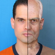 Photo: Face of a man; right half is young, left half is old