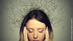 Image: young woman holding her head, with a sad expression on her face and black lines emerging from her head; Copyright: panthermedia.net/SIphotography