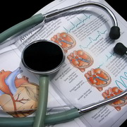 Photo: Medical book and stethoscope