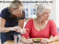Photo: Elderly woman and family caregiver